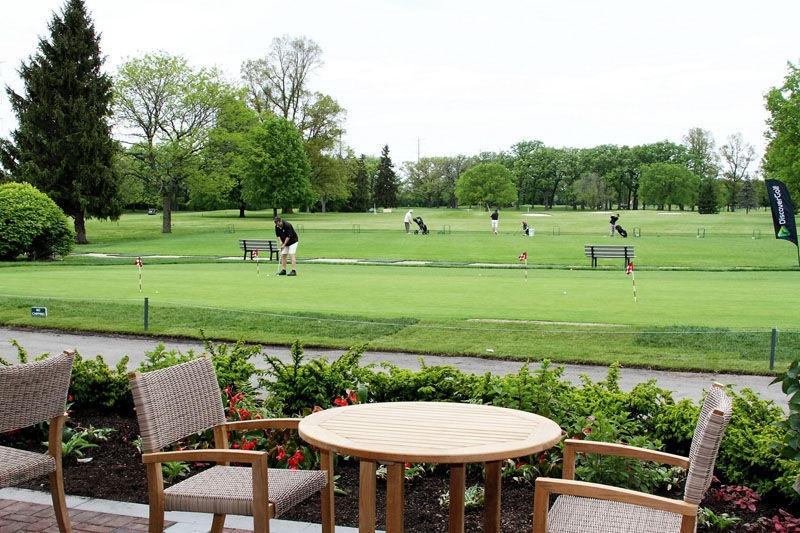 Image of the practice green and driving range at Deerpath Golf Course